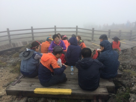 At the peak. Everyone enjoying meals.