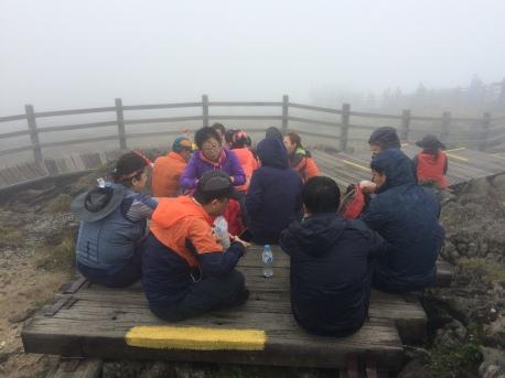 At the peak. Everyone enjoying meals.