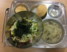 bibimbap - mixed vegetables and rice with dried seaweed, seaweed soup, puffy pastries with cream inside