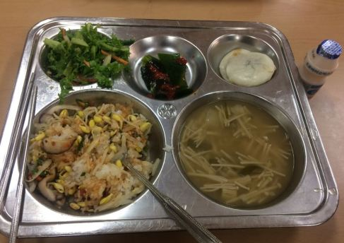 bibimbap - mixed vegatables and rice, salad, yogurt, korean pancake with honey inside, seaweed with sauce, and mushroom soup
