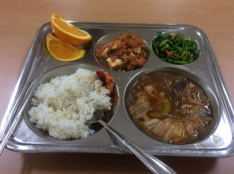 oranges, tofu with sauce, vegetables (I don't know the english name) rice, soup with squid and octopus