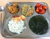 pork and potatoes, rice noodles with vegetables, cherry tomatoes, rice, kimchi, seaweed soup