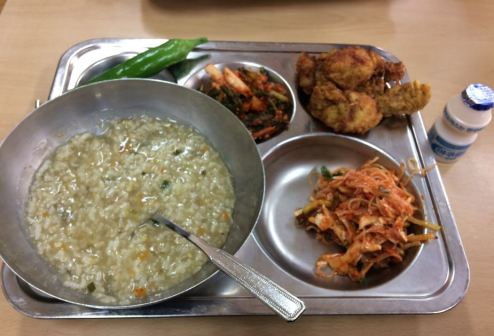 porridge, pepper, kimchi and vegetables, fried chicken, Korean style coleslaw, yogurt